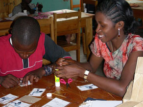 Our orphaned young people support their families by making cards.